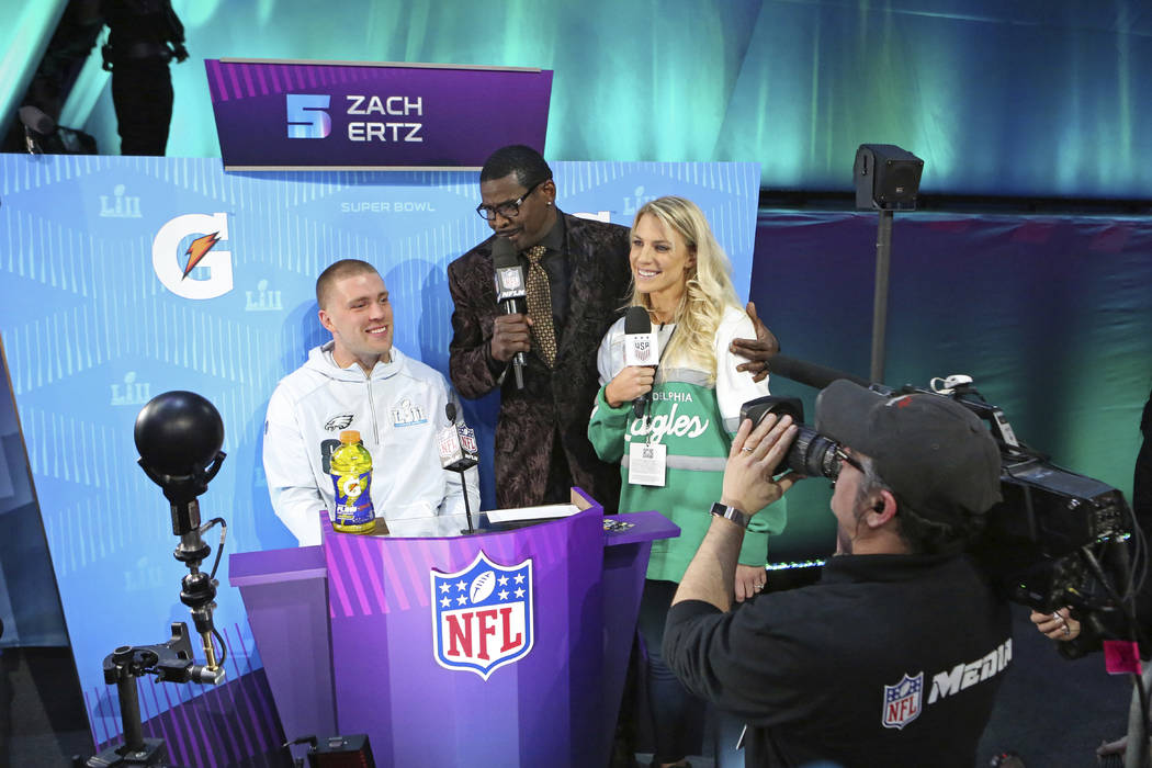 From (L-R) Philadelphia Eagles tight end Zach Ertz is interviewed by Michael Irvin, and Zach's wife Julie Ertz during opening night for the NFL Super Bowl 52 football game at Xcel Energy Center on ...