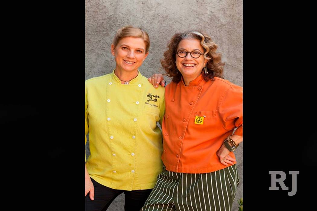 Chefs Susan Feniger (Orange Coat) and Mary Sue Milliken (Yellow Coat) photographed at Mary Sue Milliken's home in Culver City, CA.  The two chefs are the owners of Border Grill in Los Angeles. (Su ...