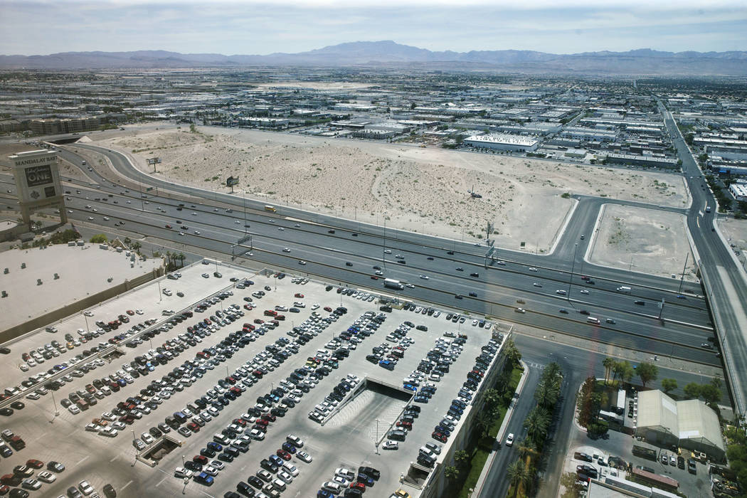 The top of the photo is the proposed site for the Raiders football stadium in Las Vegas on Wednesday, June 7, 2017. The site sits along Interstate 15, between Russell Road and Hacienda Avenue (rig ...