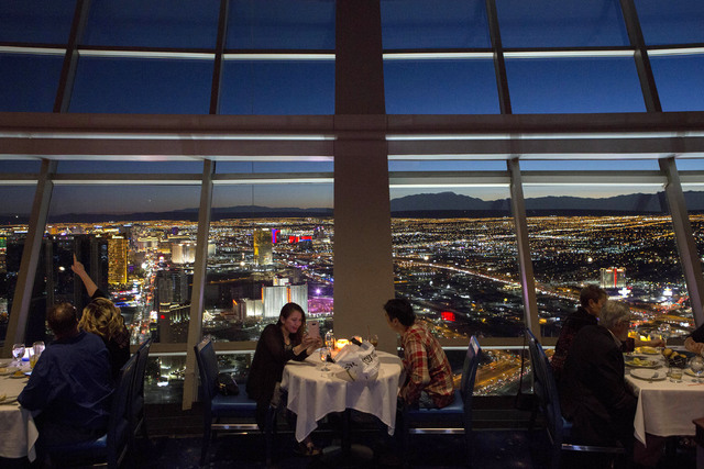Patrons enjoy a Valentines Day dinner as the sun sets on Tuesday, Feb. 14, 2017, at Top of the World restaurant at Stratosphere hotel-casino in Las Vegas. (Bridget Bennett/Las Vegas Review-Journal ...