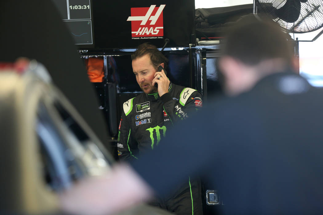 Monster Energy NASCAR Cup Series Champion Kurt Busch takes a call at the garage as members of his crew prep his Chevrolet Camaro for another run during a two-day NASCAR series test session at Las  ...
