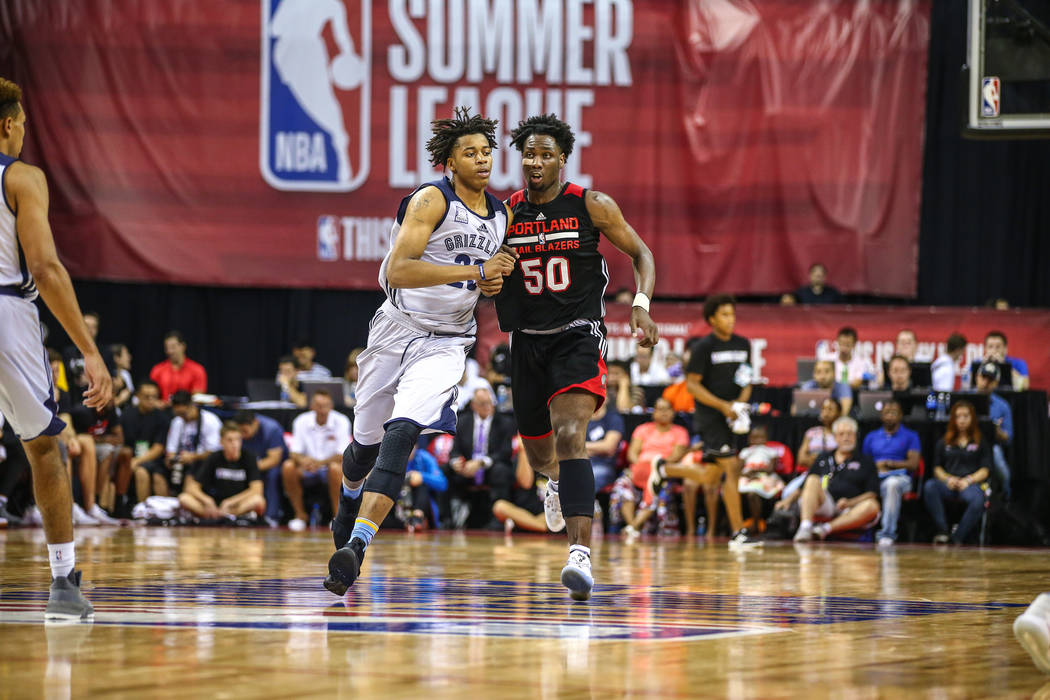 Portland Trail Blazers player Caleb Swanigan (50) competes with Memphis Grizzlies player Deyonta Davis during the NBA Summer League semifinal basketball game at Thomas and Mack Center on Sunday, J ...