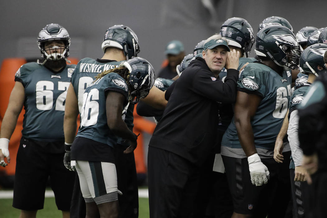 Philadelphia Eagles head coach Doug Pederson huddles with the team during practice at the team's NFL football training facility in Philadelphia, Friday, Jan. 26, 2018. The Eagles face the New Engl ...