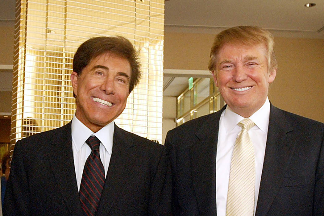 Steve Wynn, left, and Donald Trump, right, pose on Tuesday, July 12, 2005 in Las Vegas. (AP Photo/Joe Cavaretta)