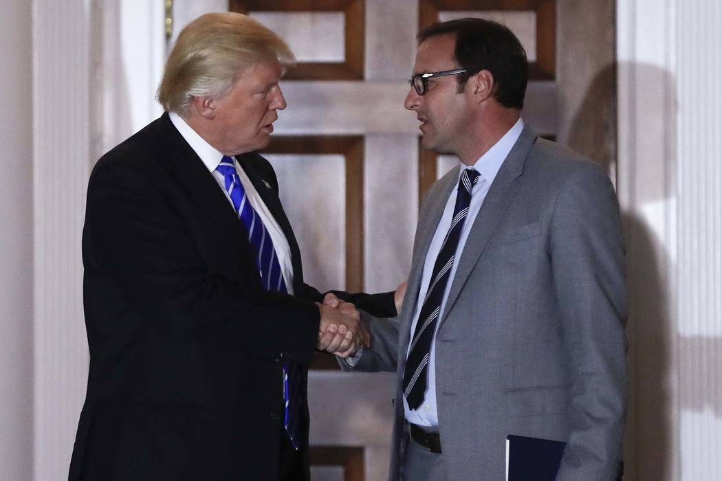 Then-President-elect Donald Trump shakes hands with Todd Ricketts at Trump's National Golf Club Bedminster clubhouse in Bedminster, N.J, Nov. 19, 2016. The Republican National Committee selected R ...