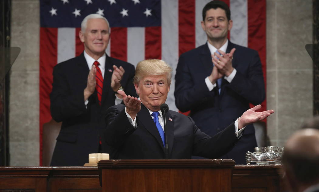 President Donald Trump gestures as delivers his first State of the Union address in the House chamber of the U.S. Capitol to a joint session of Congress Tuesday, Jan. 30, 2018 in Washington, as Vi ...
