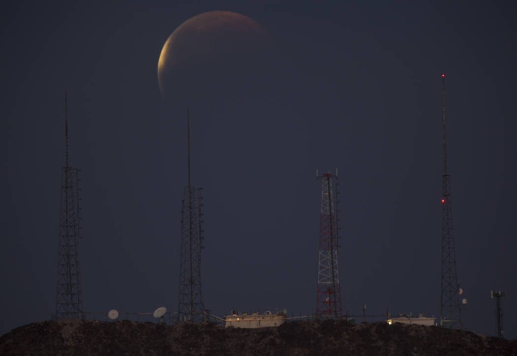 A partially eclipsed super blue blood moon over Tower Mountain, Wednesday, Jan. 31, 2018 in Las Vegas. (Richard Brian/Las Vegas Review-Journal)