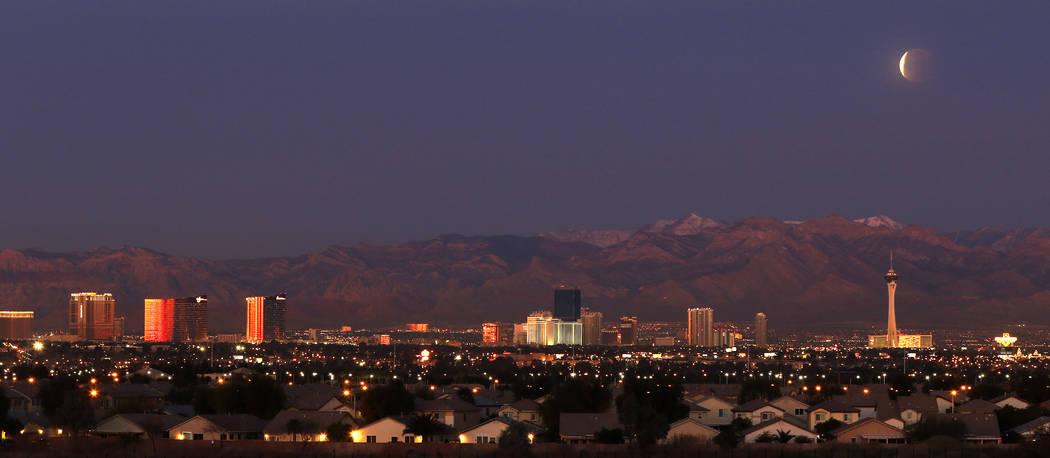 A partially eclipsed super blue blood moon over the Las Vegas Valley, Wednesday, Jan. 31, 2018 in Las Vegas. David Guzman Las Vegas Review-Journal @DavidGuzman1985