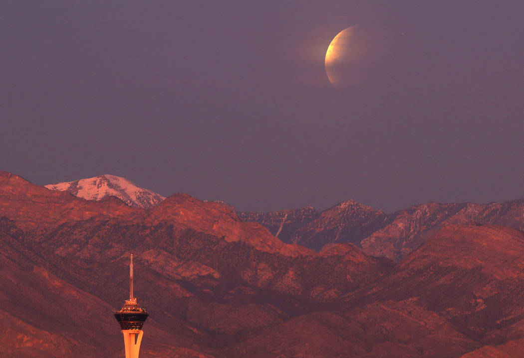 The Stratosphere tower is seen in the foreground as a partially eclipsed super blue blood moon  sets behind Mount Charleston, Wednesday, Jan. 31, 2018 in Las Vegas. David Guzman Las Vegas Review-J ...
