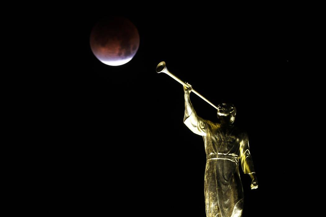 A partially eclipsed super blue blood moon is seen from the Las Vegas Mormon Temple, Wednesday, Jan. 31, 2018 in Las Vegas. David Guzman Las Vegas Review-Journal @DavidGuzman1985