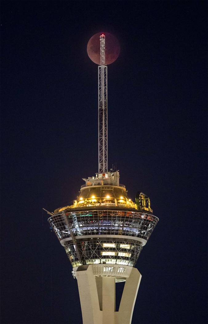 Thesuper blue blood moon over the Stratosphere in Las Vegas on Wednesday, Jan. 31, 2018.  Patrick Connolly Las Vegas Review-Journal @PConnPie