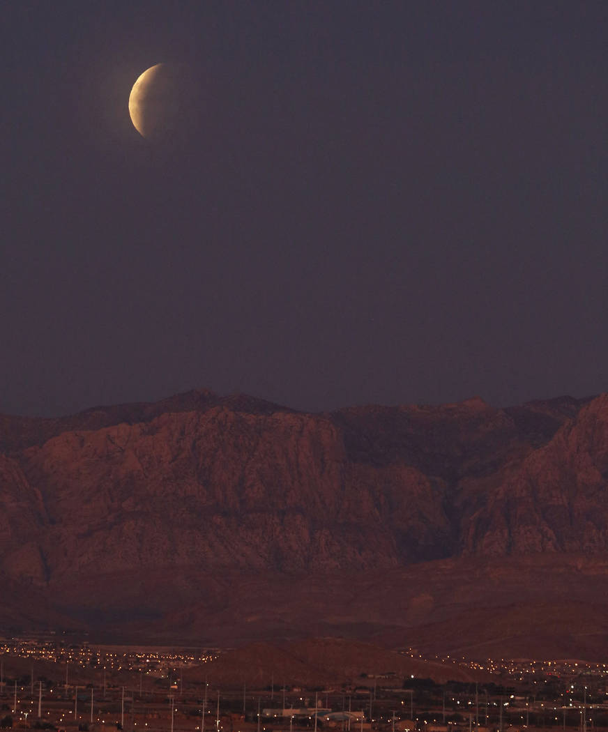 A partially eclipsed super blue blood moon is seen from Vivaldi Park on Wednesday, Jan. 31, 2018, in Henderson. (Bizuayehu Tesfaye/Las Vegas Review-Journal) @bizutesfaye