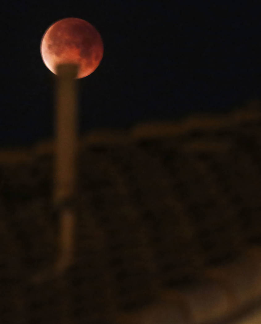 The super blue blood moon is seen from Seven Hills on Wednesday, Jan. 31, 2018, in Henderson. (Bizuayehu Tesfaye/Las Vegas Review-Journal) @bizutesfaye