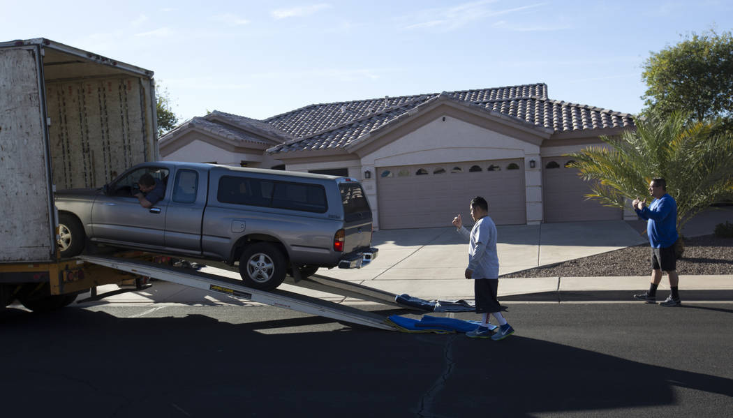 Movers deliver a vehicle to the home of Douglas Haig in Mesa, Arizona, on Wednesday, Jan. 31, 2018. Haig was identified in search warrant records from early October as a person of interest in the  ...