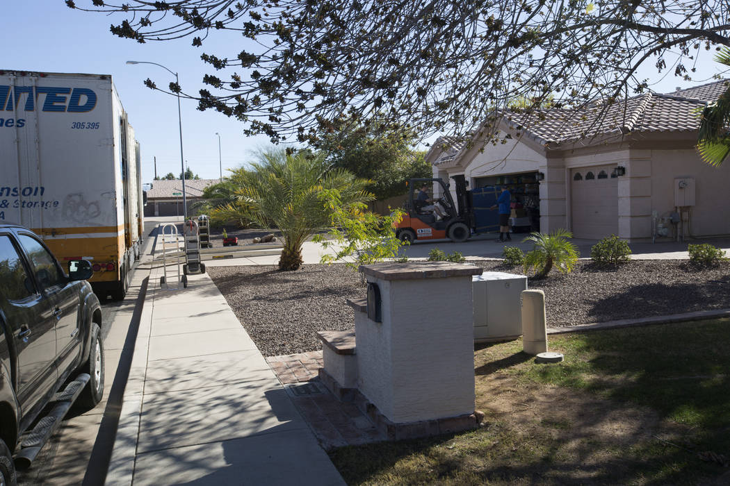 Movers deliver an item to the home of Douglas Haig in Mesa, Arizona, on Wednesday, Jan. 31, 2018. Haig was identified in search warrant records from early October as a person of interest in the La ...
