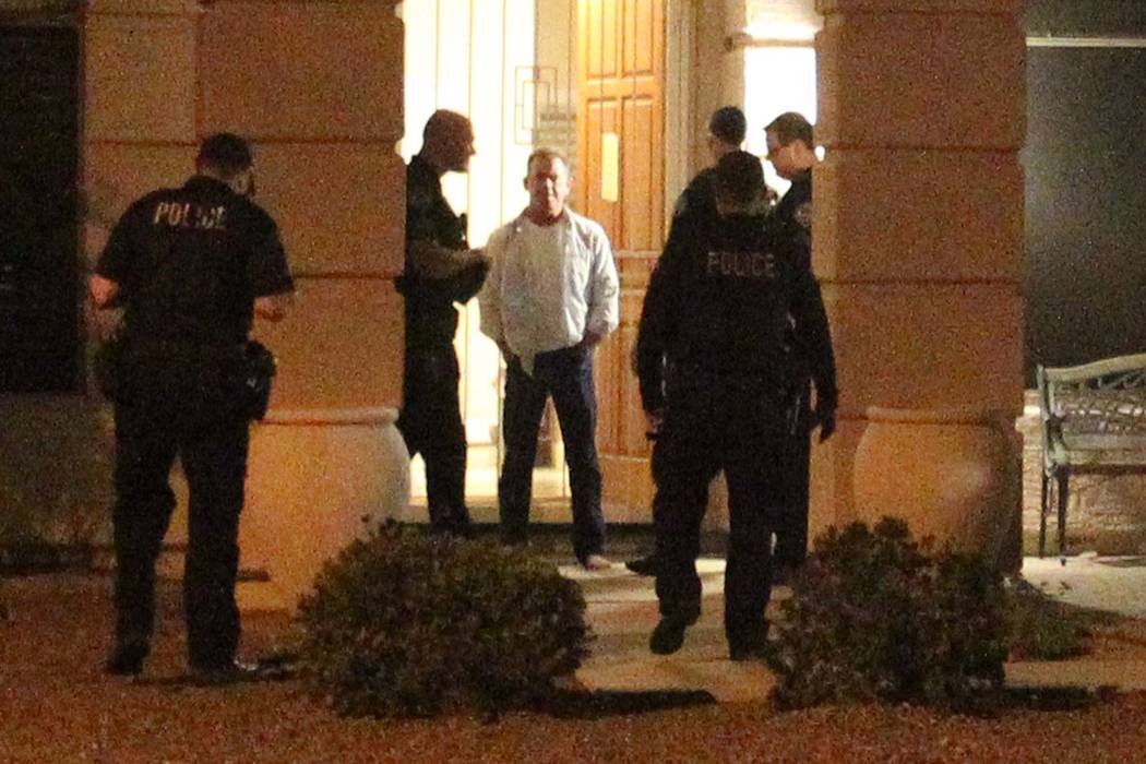 Douglas Haig, center, talks to Mesa, Ariz. police outside his home Tuesday, Jan. 30, 2018. Haig was identified in search warrant records from early October as a person of interest who may have con ...