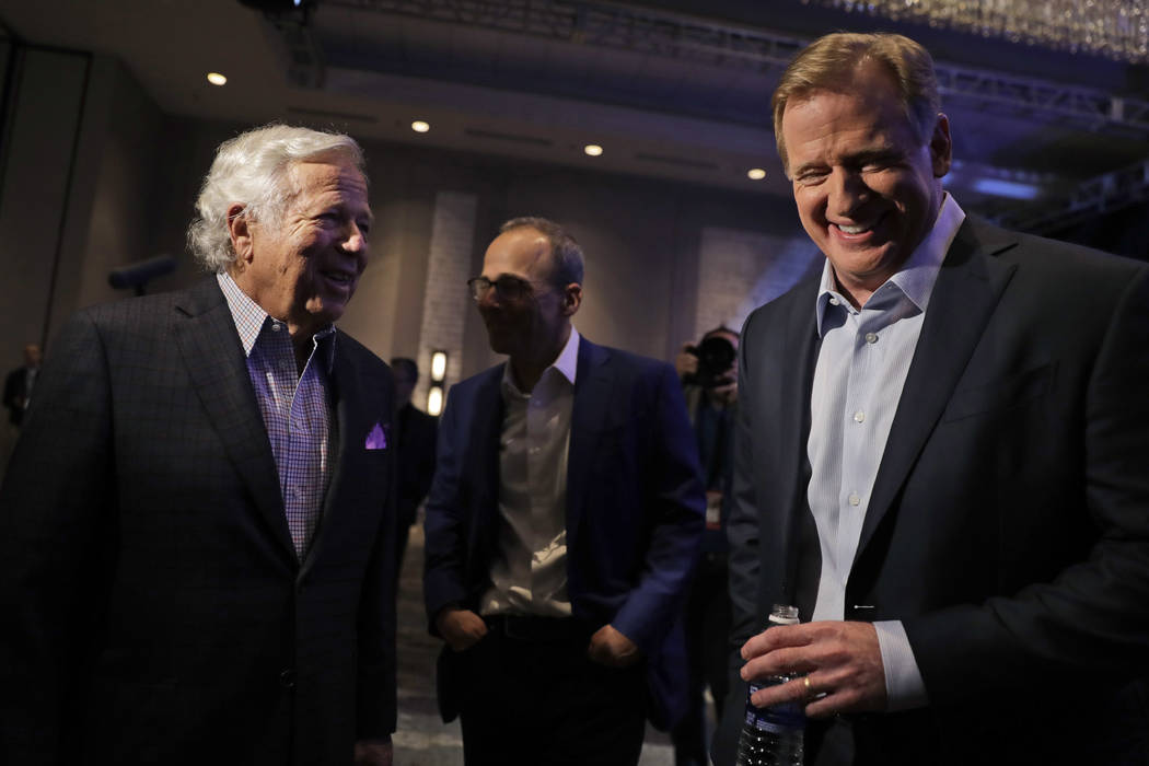 NFL Commissioner Roger Goodell, right, and New England Patriots owner Robert Kraft laugh before a news conference in advance of the Super Bowl 52 football game, Wednesday, Jan. 31, 2018, in Minnea ...