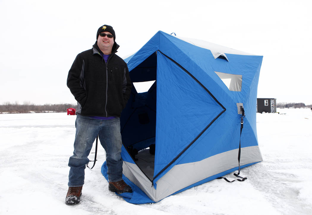 Longtime Minnesota Vikings fan Reg Proulx prepares to do some ice fishing on Lake Peltier in Anoka County, Minn., Tuesday, Jan. 30, 2018. Heidi Fang Las Vegas Review-Journal @HeidiFang