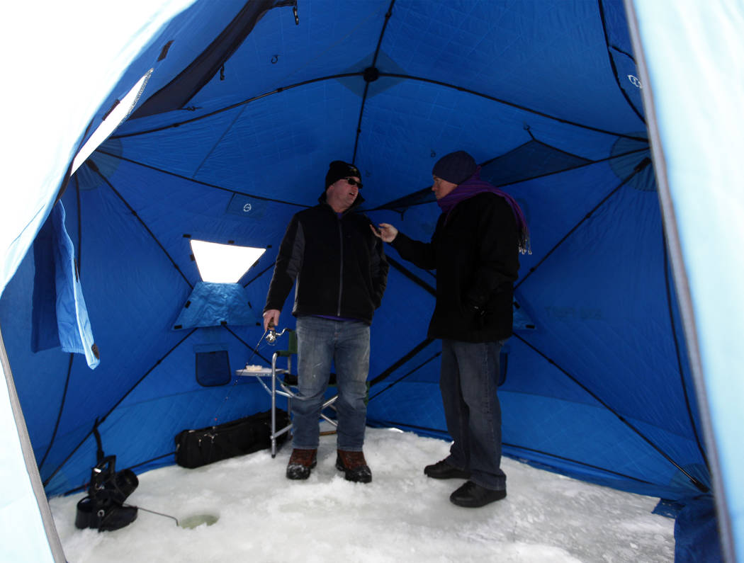 Minnesota Vikings fan Reg Proulx, left, is interviewed by Review-Journal columnist Ed Graney about ice fishing on Lake Peltier while the Super Bowl is in town in Anoka County, Minn., Tuesday, Jan. ...