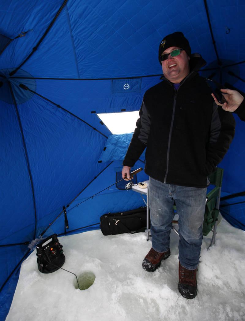 Long-time Minnesota Vikings fan Reg Proulx does some ice fishing during Super Bowl LII week on Lake Peltier in Anoka County, Minn., Tuesday, Jan. 30, 2018. Heidi Fang Las Vegas Review-Journal @Hei ...
