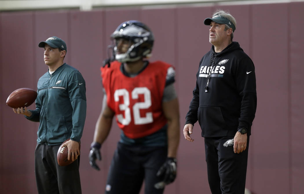 Philadelphia Eagles head coach Doug Pederson, right, keeps watch during a practice for the NFL Super Bowl 52 football game Wednesday, Jan. 31, 2018, in Minneapolis. Philadelphia is scheduled to fa ...