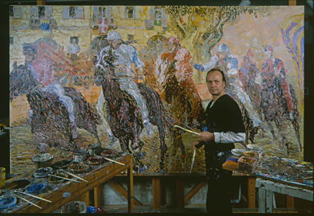 Marco Sassone, 75, poses in front of one of his paintings. Photo courtesy of Marco Sassone.