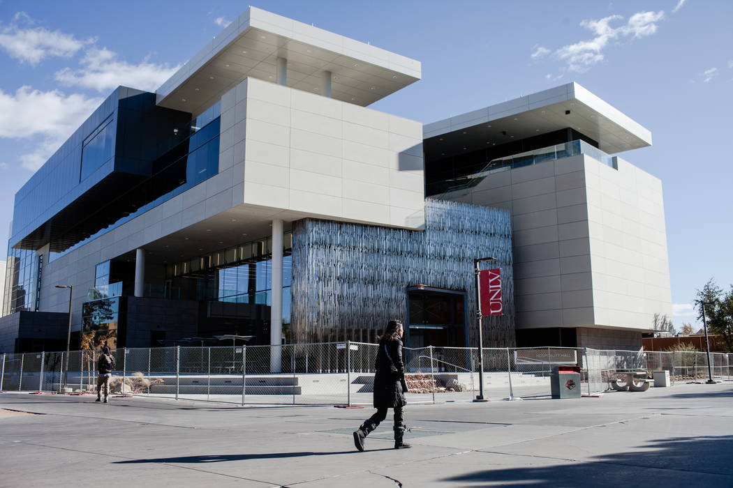 A person walks past Hospitality Hall at UNLV in Las Vegas, Thursday, Dec. 21, 2017. The building is set to open in late January 2018. Joel Angel Juarez Las Vegas Review-Journal @jajuarezphoto