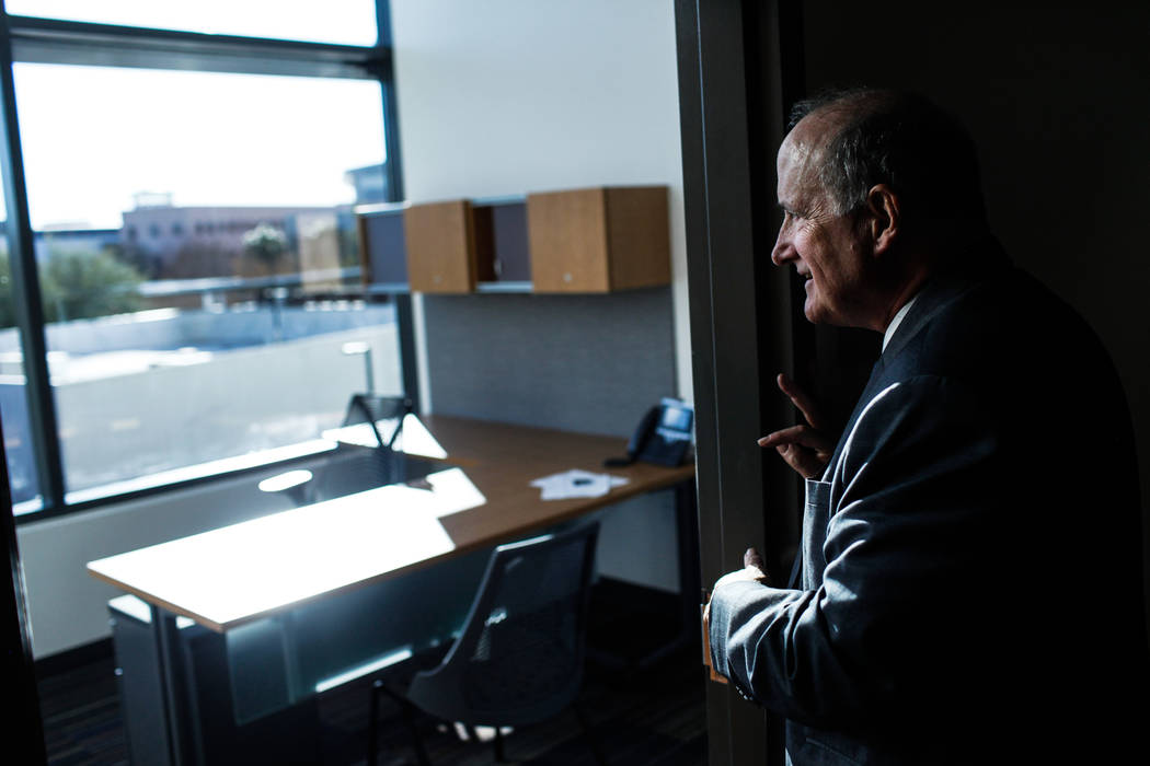 Stowe Shoemaker, dean of the William F. Harrah College of Hotel Administration, peers inside an office at Hospitality Hall at UNLV in Las Vegas, Thursday, Dec. 21, 2017. The building is set to ope ...