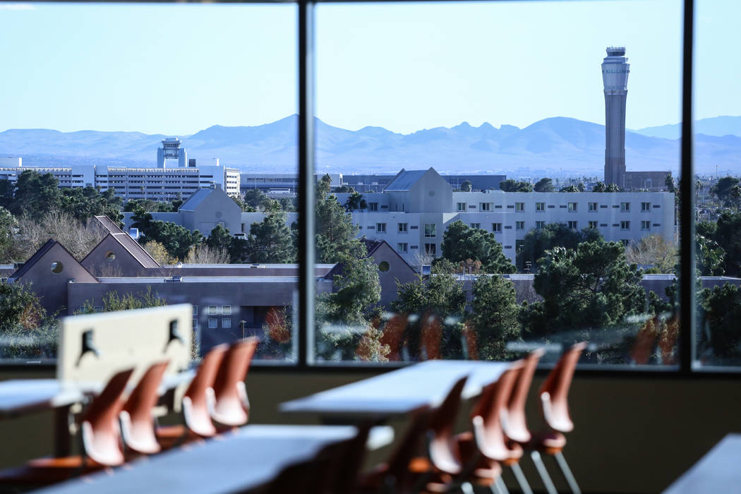 An air traffic control tower at McCarran International Airport is seen in the distance from a classroom at Hospitality Hall at the UNLV in Las Vegas, Thursday, Dec. 21, 2017. The building is set t ...