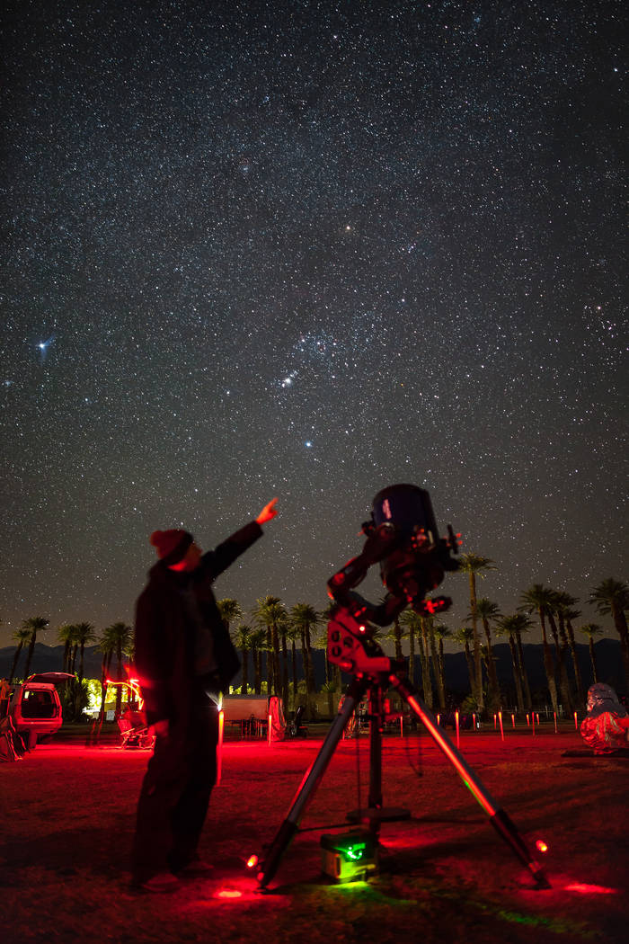 "Greg McKay, a Henderson resident and a member of the Las Vegas Astronomical Society, a group of local enthusiasts, said once a month, they have a ""star party"" in locations such as Red Rock Can ..."