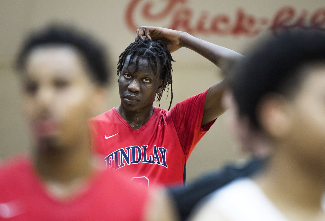 Findlay Prep's Bol Bol heads to the locker room after the team defeated Paul VI Catholic in the Chick-fil-a basketball tournament at Richland Northeast High School on Thursday, Dec 21, 2017, in Co ...