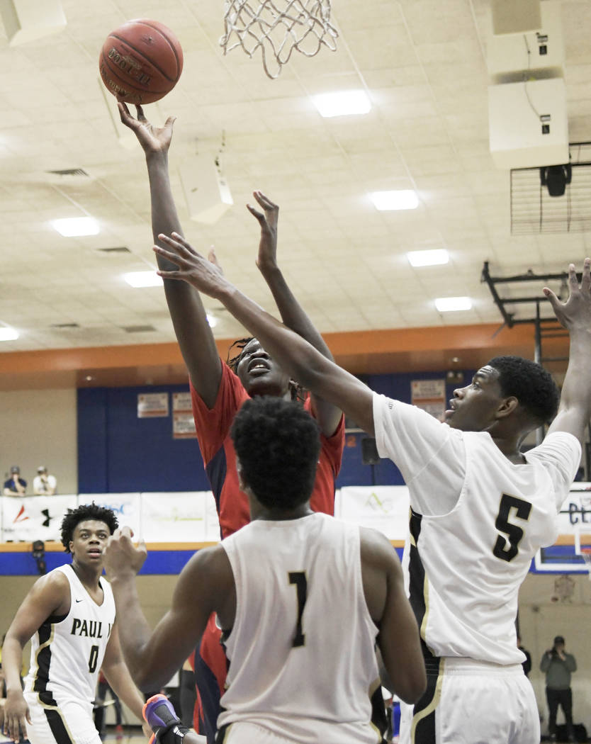 Findlay Prep's Bol Bol goes to the basket against Paul VI Catholic during the Chick-fil-a basketball tournament at Richland Northeast High School on Thursday, Dec 21, 2017, in Columbia, S.C. Bol i ...