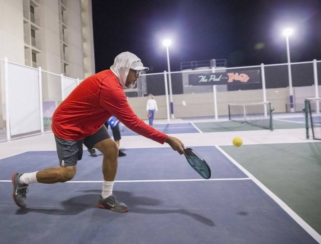 Vincent Rivera hits a forehand return during a pickleball mixer on Thursday, Dec. 7, 2017, at the Plaza Hotel & Casino, in Las Vegas. Benjamin Hager Las Vegas Review-Journal @benjaminhphoto