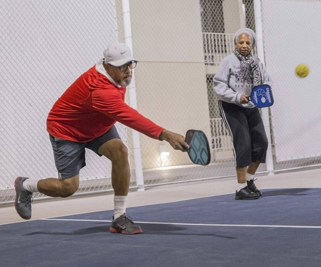 Vincent Rivera, left, hits a forehand return during a pickleball mixer on Thursday, Dec. 7, 2017, at the Plaza Hotel & Casino, in Las Vegas. Benjamin Hager Las Vegas Review-Journal @benjaminhphoto