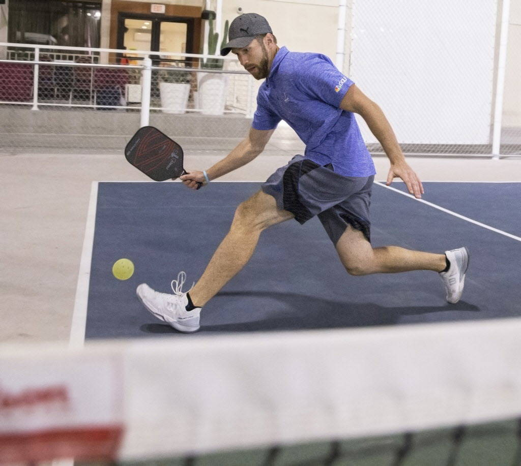Instructor Isaac Johnson slides to the baseline to hit a forehead return during a pickleball mixer on Thursday, Dec. 7, 2017, at the Plaza Hotel & Casino, in Las Vegas. Benjamin Hager Las Vega ...