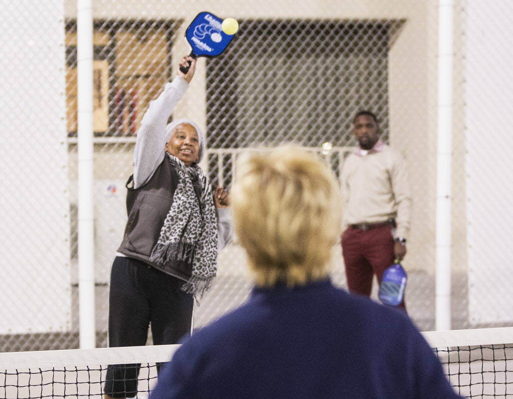 Shirley White, left/back, returns a serve during a pickleball mixer on Thursday, Dec. 7, 2017, at the Plaza Hotel & Casino, in Las Vegas. Benjamin Hager Las Vegas Review-Journal @benjaminhphoto