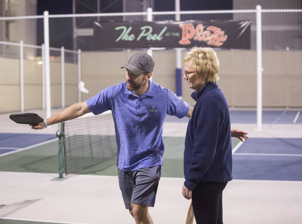 Instructor Isaac Johnson, left, helps Sandy Foley with her backhand during a pickleball mixer on Thursday, Dec. 7, 2017, at the Plaza Hotel & Casino, in Las Vegas. Benjamin Hager Las Vegas Rev ...