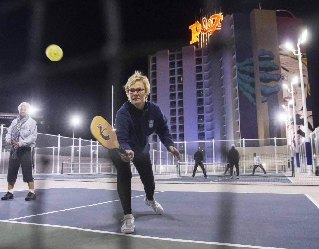 Sandy Foley hits a backhand return at net during a pickleball mixer on Thursday, Dec. 7, 2017, at the Plaza Hotel & Casino, in Las Vegas. Benjamin Hager Las Vegas Review-Journal @benjaminhphoto