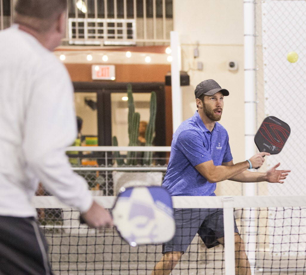 Instructor Isaac Johnson, right, hits a backhand return during a pickleball mixer on Thursday, Dec. 7, 2017, at the Plaza Hotel & Casino, in Las Vegas. Benjamin Hager Las Vegas Review-Journal  ...