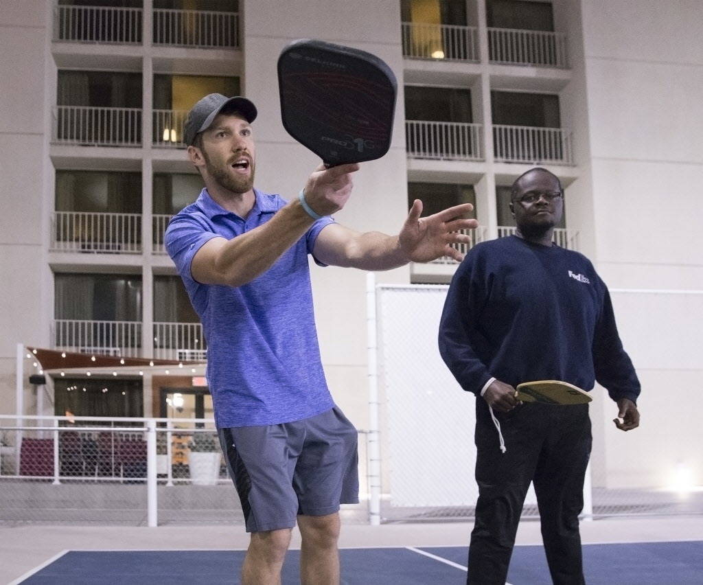 Instructor Isaac Johnson, left, hits a forehand return during a pickleball mixer on Thursday, Dec. 7, 2017, at the Plaza Hotel & Casino, in Las Vegas. Benjamin Hager Las Vegas Review-Journal @ ...