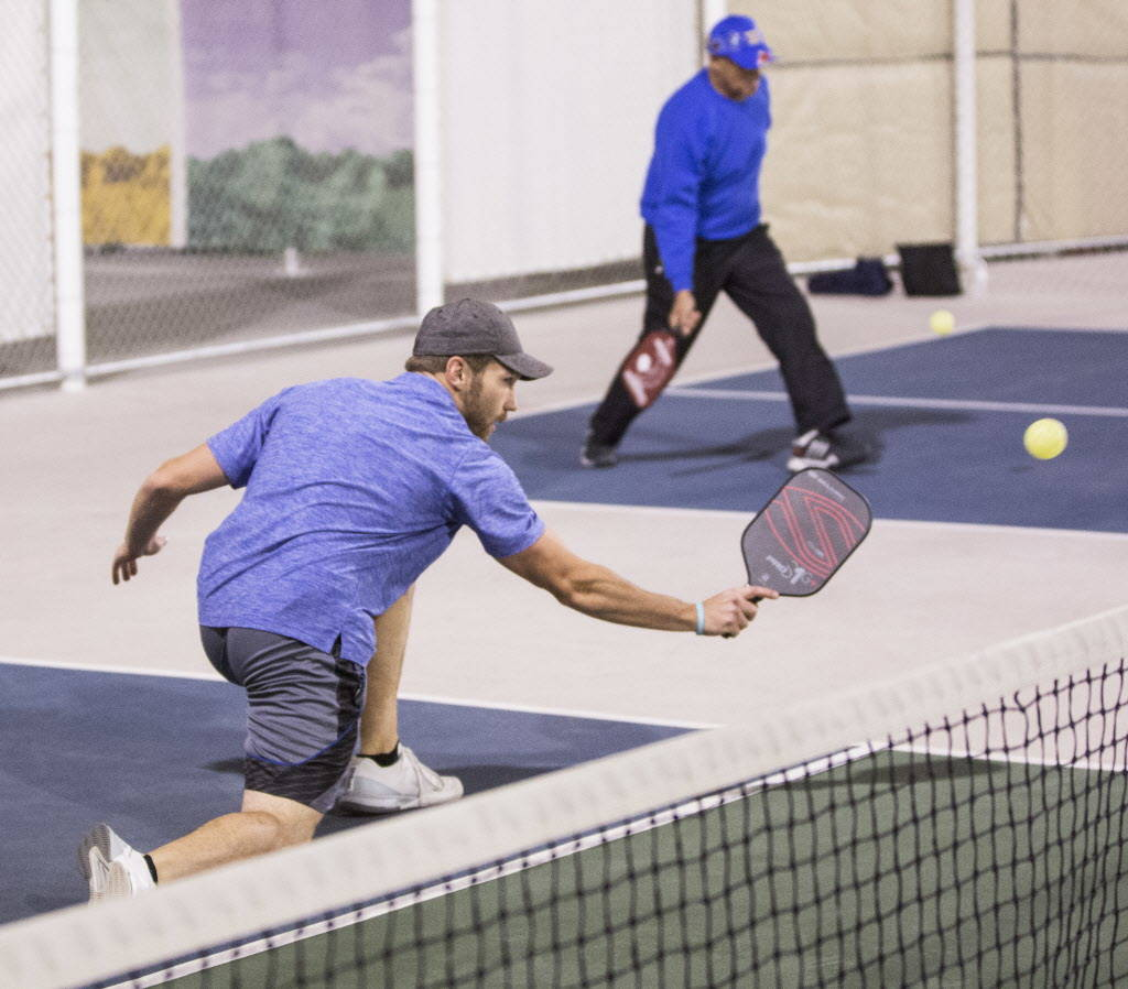 Instructor Isaac Johnson, left, hits a backhand return during a pickleball mixer on Thursday, Dec. 7, 2017, at the Plaza Hotel & Casino, in Las Vegas. Benjamin Hager Las Vegas Review-Journal @ ...