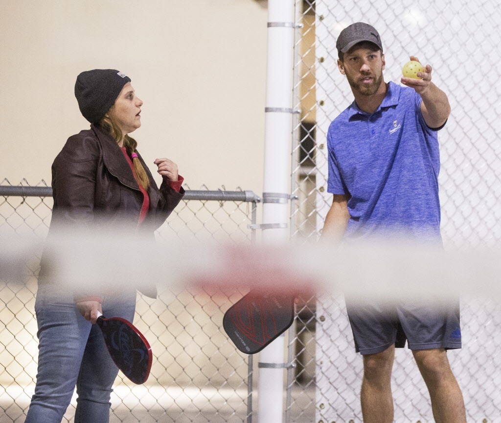 Instructor Isaac Johnson, right, explains the scoring system to Kimberly Pozucek during a pickleball mixer on Thursday, Dec. 7, 2017, at the Plaza Hotel & Casino, in Las Vegas. Benjamin Hager  ...