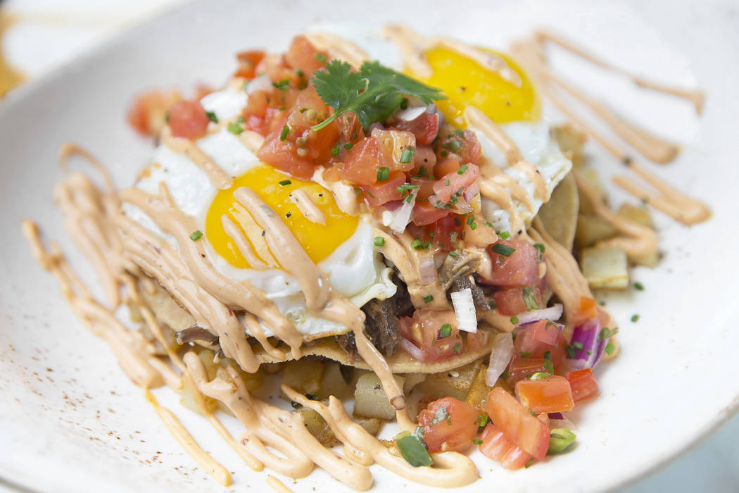 Macho machaca hash with shredded braised beef short ribs, poblano chiles, potatoes, onions, chipotle crema, pico de gallo, sunny up at Lucky Penny on Monday, Dec. 18, 2017, in the Palms hotel-casi ...