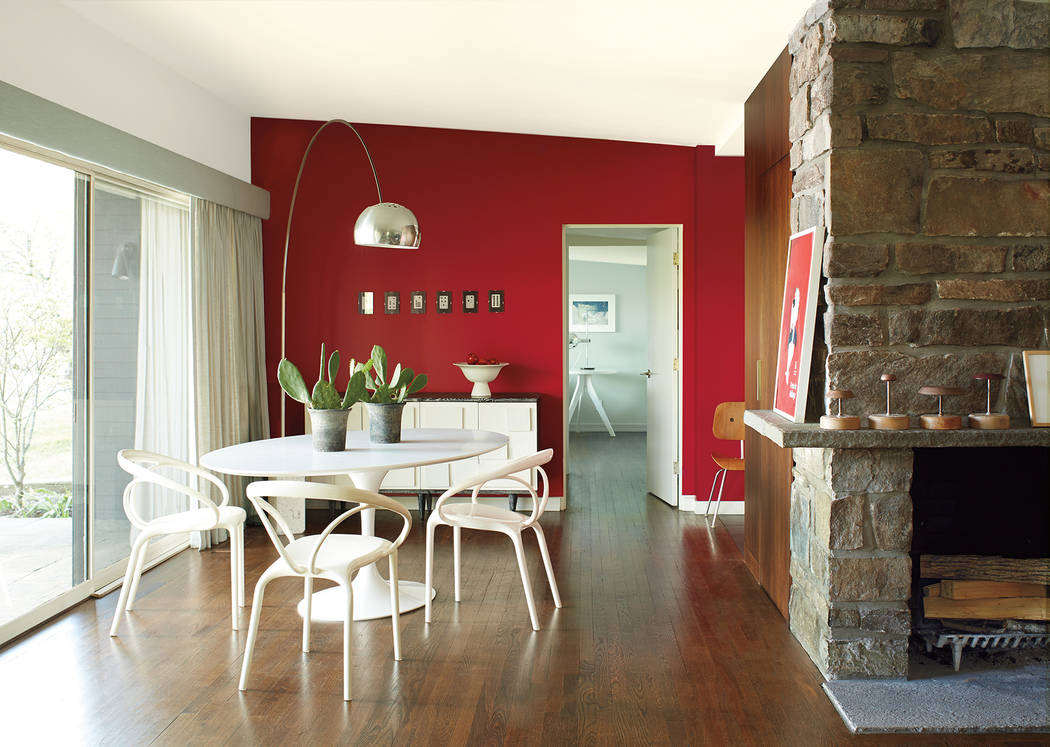 Benjamin Moore & Co. Benjamin Moore's Caliente is a vibrant, charismatic shade of red.