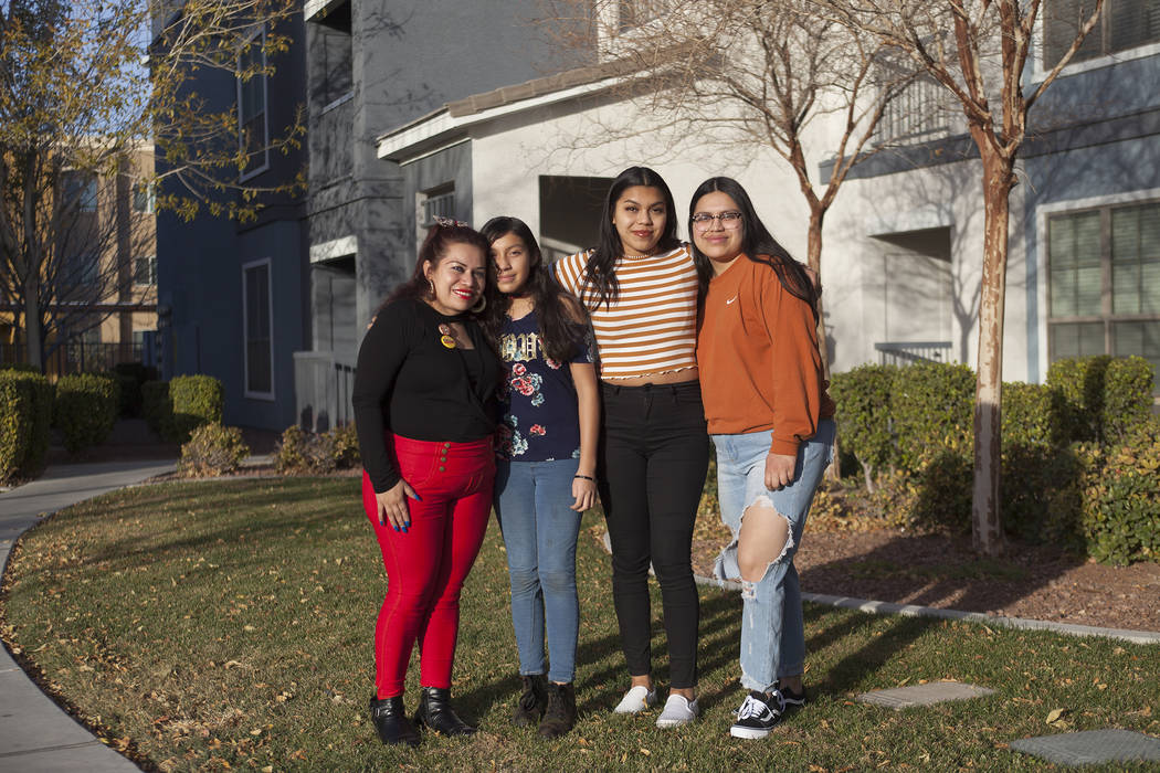 Ericka Lopez, from left, and her daughters Emily Garcia, 12, Ana Ramos Lopez, 16, and Glenda Ramos Lopez, 20, in front of their home in Las Vegas, Friday, Dec. 22, 2017. Lopez fears her family wil ...