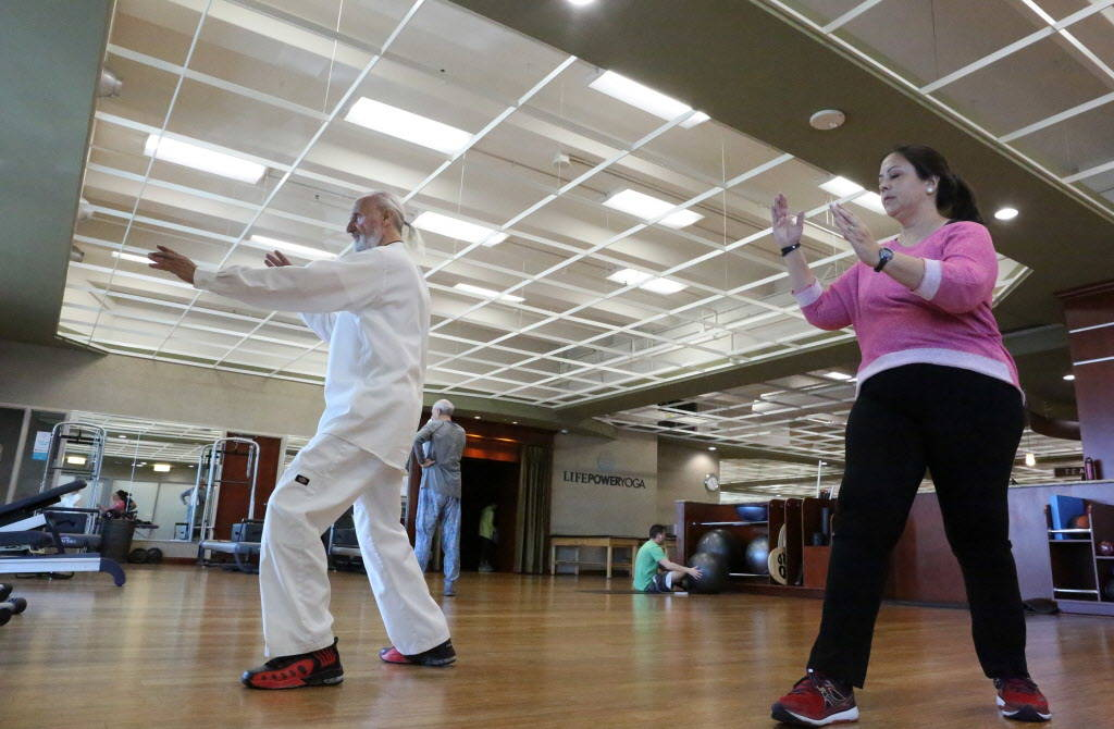 Life Time Fitness Ambassador Laurence Berkley instructs student, Connie Kellers, in Tai Chi at the Life Time Athletic in Summerlin on Wednesday, Dec. 20, 2017. Michael Quine Las Vegas Review-Journ ...