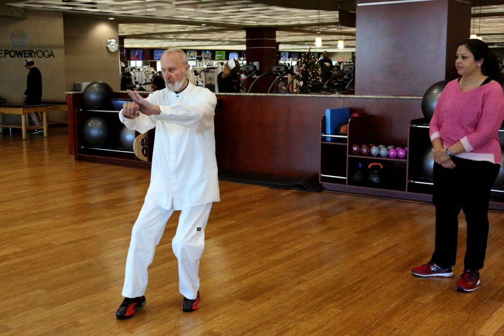 Life Time Fitness Ambassador Laurence Berkley demonstrates movement in Tai Chi to student, Connie Kellers, at the Life Time Athletic in Summerlin on Wednesday, Dec. 20, 2017. Michael Quine Las Veg ...