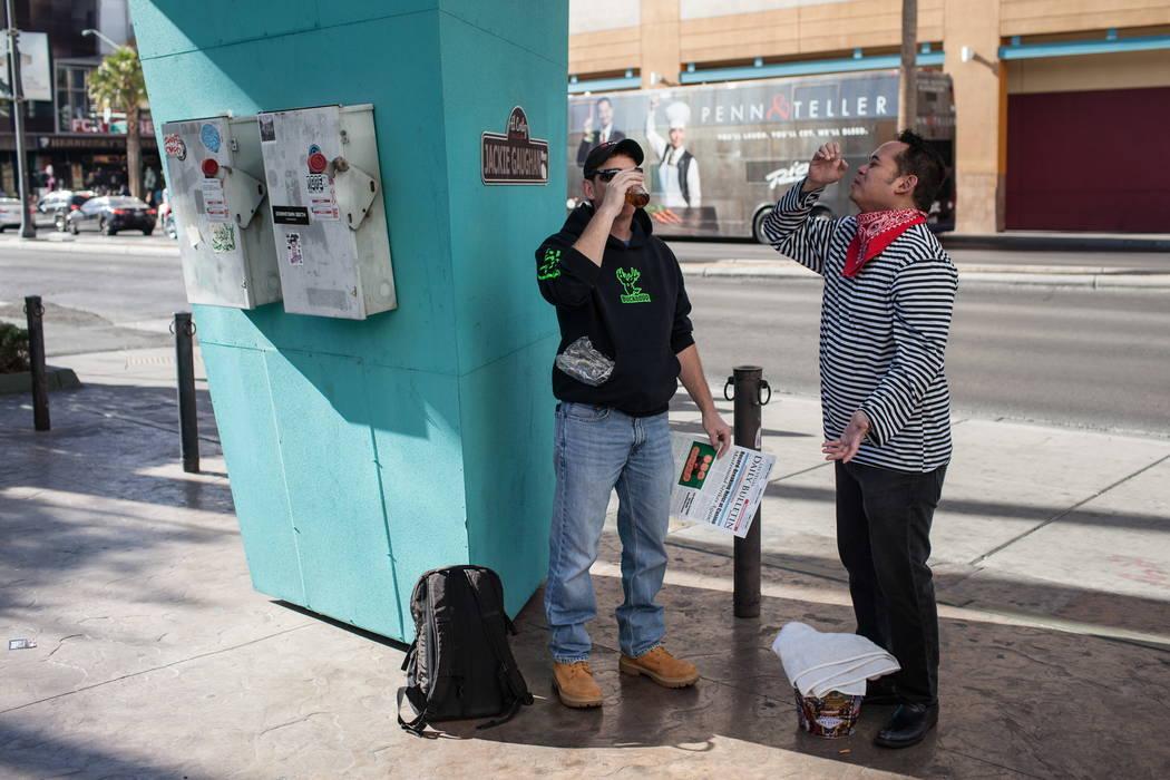 Bill Farkaly of Scranton, Pa., 46, left, takes a drink as mime artist Ren Bautista, right, mimics him during the Alibi Las Vegas in Las Vegas, Saturday, Dec. 30, 2017. Joel Angel Juarez Las Vegas  ...