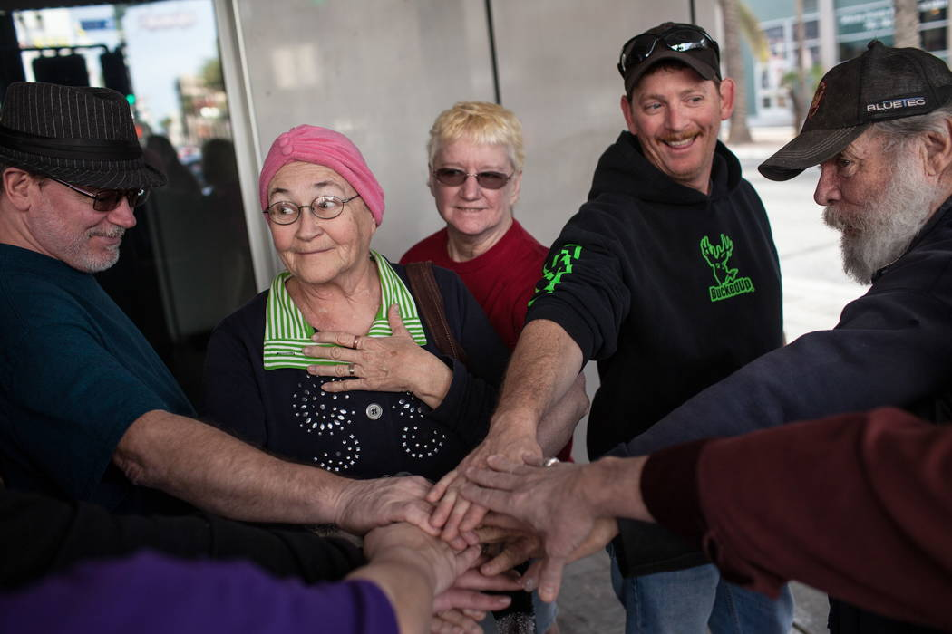 Su-Z Allen of Las Vegas, 70, second from left, smiles as she places her hand in the middle of a group during the Alibi Las Vegas in Las Vegas, Saturday, Dec. 30, 2017. Joel Angel Juarez Las Vegas  ...