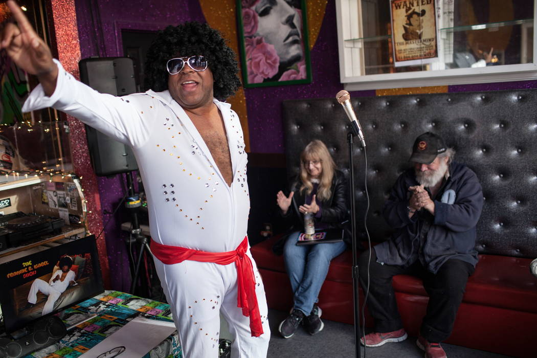 "Elvis impersonator James White serenades the group with ""Jailhouse Rock.""  Joel Angel Juarez Las Vegas Review-Journal @jajuarezphoto"